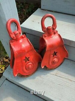 2 Antique Vintage Starline Cast Iron And Wood Barn Pulleys. Nice