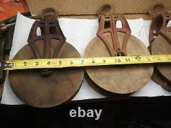 3 Antique Vintage Cast Iron And Wood ORNATE Barn PULLEYS Rustic Decor Primitive