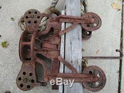 ANTIQUE CAST IRON HAY TROLLEY UNLOADER mounted on 60 wood beam ORIGINAL