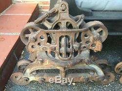 Antique hay trolley cloverleaf unloader FE Meyer pair with tracks and hay tongs