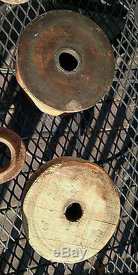 Cache of antique pulleys