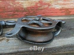 TWO Antique/VINTAGE CAST Iron AND WOOD PULLEYS ORNATE PRIMITIVE RUSTIC DECOR